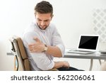 handsome young man suffering... | Shutterstock . vector #562206061