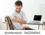 handsome young man suffering... | Shutterstock . vector #562206061