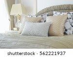 golden and silver pillows... | Shutterstock . vector #562221937