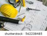 construction plans with helmet... | Shutterstock . vector #562238485