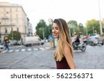 laughing young woman portrait... | Shutterstock . vector #562256371