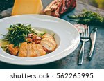 caesar salad with chicken and... | Shutterstock . vector #562265995