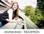 home owner is happy with solar... | Shutterstock . vector #562269631