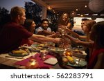 friends make a toast at a... | Shutterstock . vector #562283791