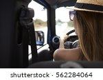 young woman driving open top... | Shutterstock . vector #562284064