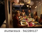friends talking at a dinner... | Shutterstock . vector #562284127