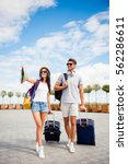 two young tourists with baggage ... | Shutterstock . vector #562286611
