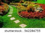 Pathway In Garden Green Lawns...