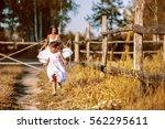 little happy girl runs away...   Shutterstock . vector #562295611