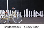 old school bike against an... | Shutterstock . vector #562297354