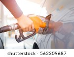 grey car at gas station being... | Shutterstock . vector #562309687