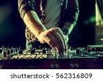 dj playing music at mixer... | Shutterstock . vector #562316809