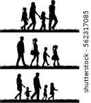silhouette family on a walk. | Shutterstock .eps vector #562317085