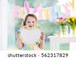 happy little girl in bunny ears ... | Shutterstock . vector #562317829