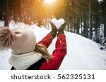 Young Woman Holding Snow Heart...
