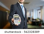 businessman is offering payment ... | Shutterstock . vector #562328389