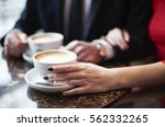 close up of couple drinking... | Shutterstock . vector #562332265