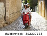 couple riding motor scooter in... | Shutterstock . vector #562337185