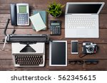 old and modern devices on... | Shutterstock . vector #562345615