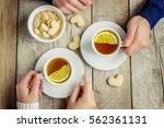 hot nye with lemon in hands....   Shutterstock . vector #562361131