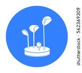 golf ball and clubs on grass... | Shutterstock .eps vector #562369309