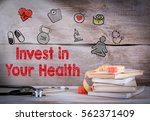 invest in your health. stack of ... | Shutterstock . vector #562371409