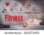 fitness concept. stack of books ... | Shutterstock . vector #562371451