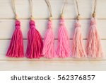 pink tassels. background of... | Shutterstock . vector #562376857