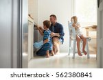 father and children baking... | Shutterstock . vector #562380841