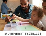 children and father painting... | Shutterstock . vector #562381135