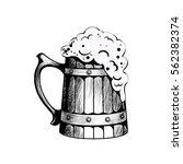 wooden beer mug with beer... | Shutterstock .eps vector #562382374