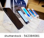 mobile smartphone in electronic ... | Shutterstock . vector #562384081