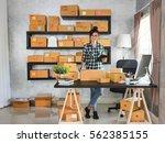 happy young entrepreneur ... | Shutterstock . vector #562385155