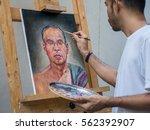 Artist Painting Portrait Of...