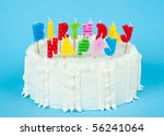 white birthday cake with candles | Shutterstock . vector #56241064