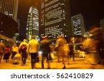 blurred light motion people... | Shutterstock . vector #562410829