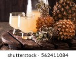 pineapple slices and juice in... | Shutterstock . vector #562411084