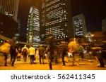 blurred light motion people... | Shutterstock . vector #562411345
