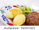 a plate with potatoes  meat and ... | Shutterstock . vector #562417621