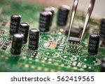 assembling a circuit board.... | Shutterstock . vector #562419565