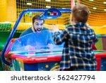 joyful bearded father and son... | Shutterstock . vector #562427794