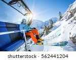 skier sitting at ski lift in... | Shutterstock . vector #562441204