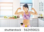 young smiling sportive woman in ... | Shutterstock . vector #562450021