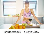 smiling sporty woman looking at ... | Shutterstock . vector #562450357