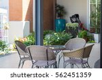 brown chairs and glass table   | Shutterstock . vector #562451359