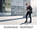 front view of a businessman... | Shutterstock . vector #562453627