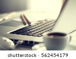 closeup of workspace with... | Shutterstock . vector #562454179