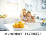 young mother and daughter... | Shutterstock . vector #562456834