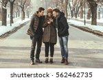 friends having fun outdoors... | Shutterstock . vector #562462735