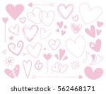 pink doodle heart designs on... | Shutterstock . vector #562468171